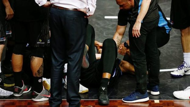 JANUARY 26: Players and staff members of the Breakers show concerns as they gather around Akil Mitchell who suffers a serious eye injury during the round 17 NBL match between the New Zealand Breakers and the Cairns Taipans at the North Shore Events Centre on January 26, 2017 in Auckland, New Zealand.