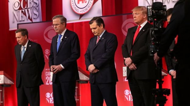 Republican presidential candidates (L-R) Ohio Governor John Kasich, Jeb Bush, Sen. Ted Cruz (R-TX) and Donald Trump observe a moment of silence for U.S. Supreme Court Justice Antonin Scalia,