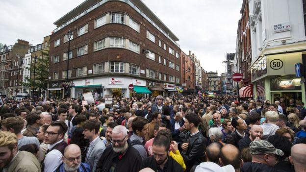 Vigil for victims of Orlando nightclub shooting outside Admiral Duncan pub on Old Compton Street, Soho, London. 13 June 2016