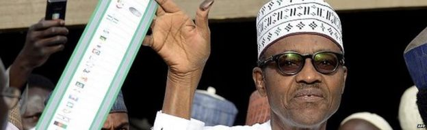 Muhammdu Buhari with a ballot paper in Nigeria on 28 March 2015