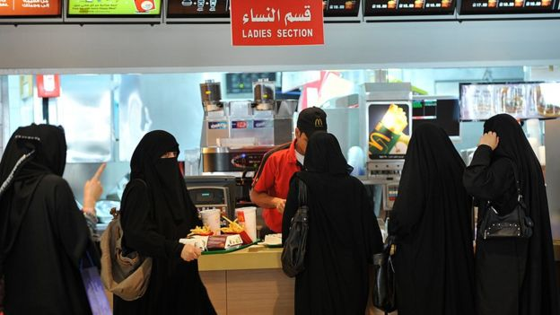 Saudi women wait in line in the women's section at fast-food restaurant in a mall in the capital Riyadh on 26 September 2011.