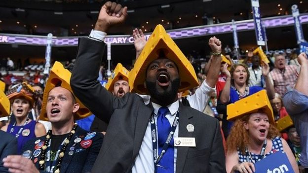 Delegates from the US state of Wisconsin cheer from the floor during the fourth and final day of the Democratic National Convention