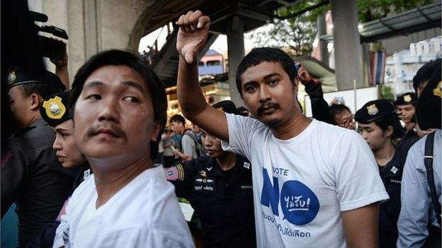 Thai election authorities on Wednesday filed their first charge under a law banning campaigning and debate before a referendum on a controversial new constitution, as the junta tightens its grip on free speech.