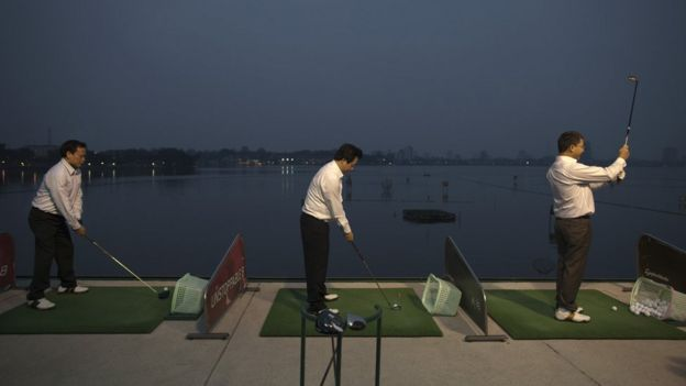 Men playing golf in Hanoi