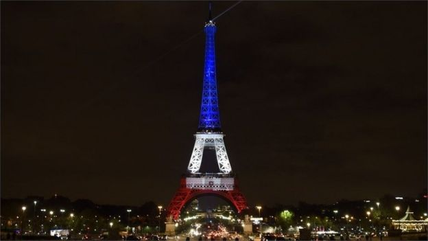 Eiffel Tower, lit in the colours of the French flag, 16 November 2015