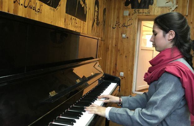 Negin playing the piano