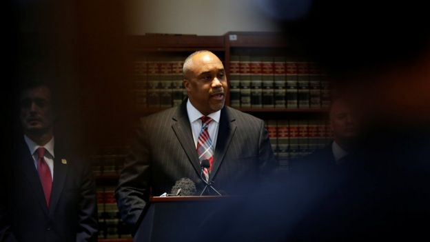 US attorney Robert Capers, centre, pictured at a press conference on Friday 20 January