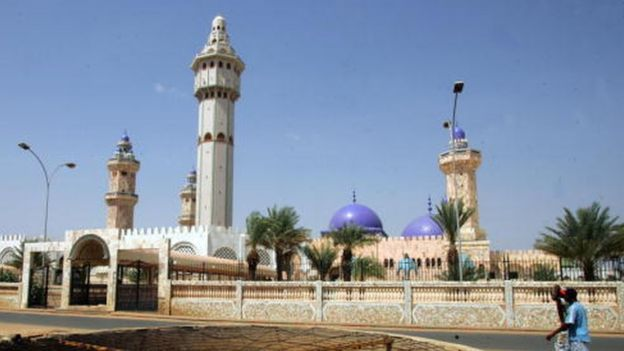 People cross the street in front of the Great Mosque in Touba, the holy city of Mouridism, 01 November 2007
