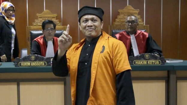 Islamic militant Ali Hamka gestures as he enters a courtroom prior to the start of his sentencing hearing at West Jakarta District Court in Jakarta, Indonesia, Thursday, Oct. 20, 2016.