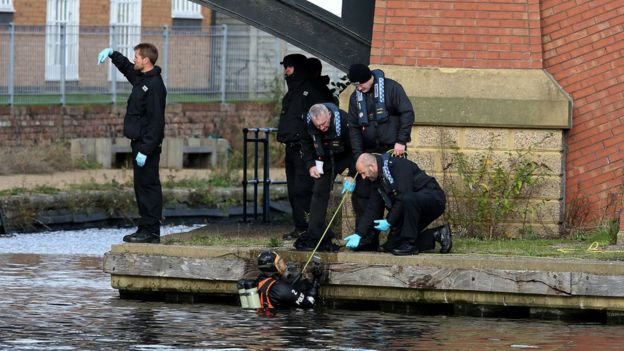 Divers search canal for evidence