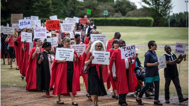 Lecturers and staff of Witwatersrand University demonstrate in support of the free education movement and against violence on campus on September 30, 2016 in Johannesburg.