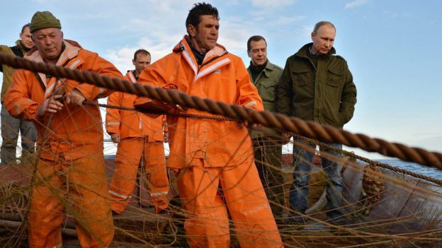 President Putin and Prime Minister Medvedev visit fishermen during the Duma election campaign