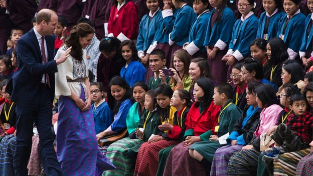 Duke and Duchess of Cambridge greeting crowds in Bhutan