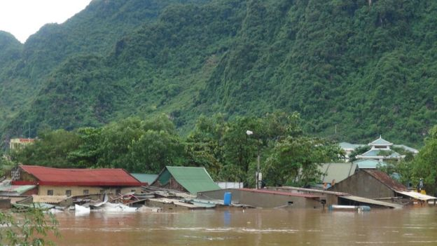 Submerged homes are seen in Bo Trach district of the central Vietnamese province of Quang Binh on 15 October 2016