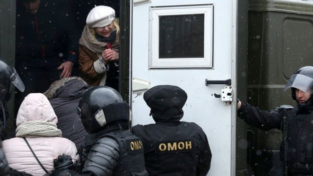 Police officers put protesters in a van during a rally in Minsk, Belarus, 25 March 2017