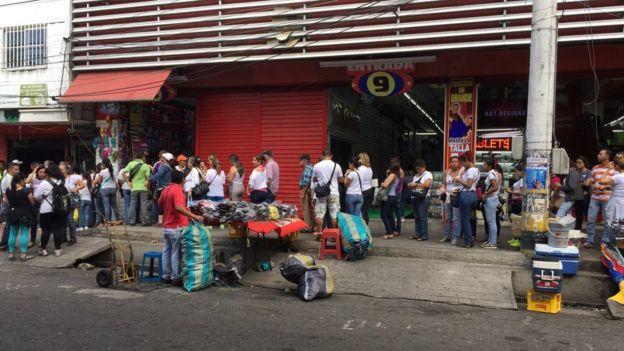 Venezuelans queue to exchange their money in Cucuta, Colombia