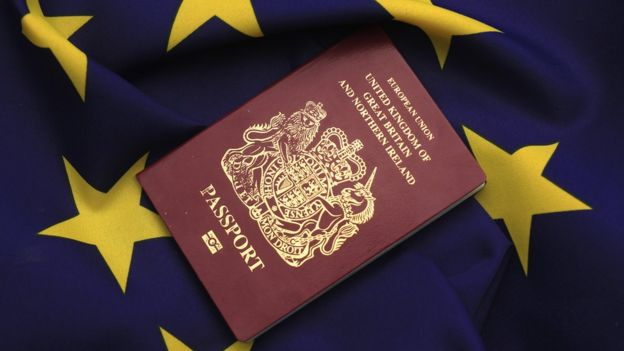 A United Kingdom passport sits on a European Union flag (March 2016)
