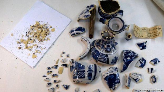 Broken vase and pieces