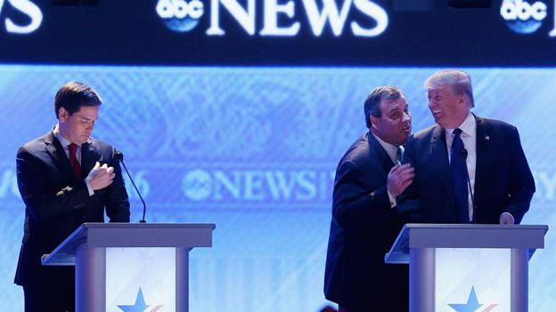 Chris Christie and Donald Trump joke at a primary debate in New Hampshire.