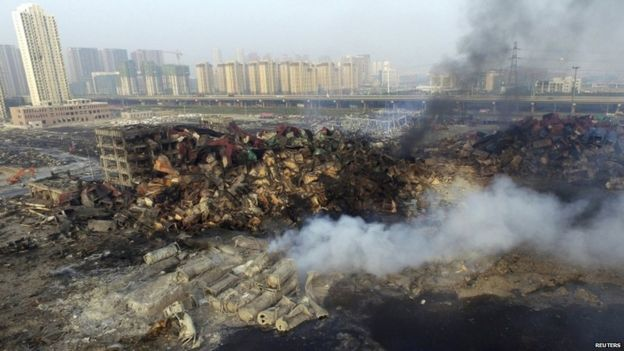 Smoke rises from debris at Tianjin blast site, 15 August 2015