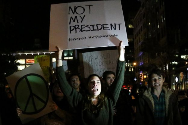 Demonstrators shout slogans at a protest in Union Square against President-elect Donald Trump in Manhattan, New York, 10 November