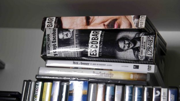 View of books and DVDs at Brazilian drug trafficker Jarvis Chimenes Pavao