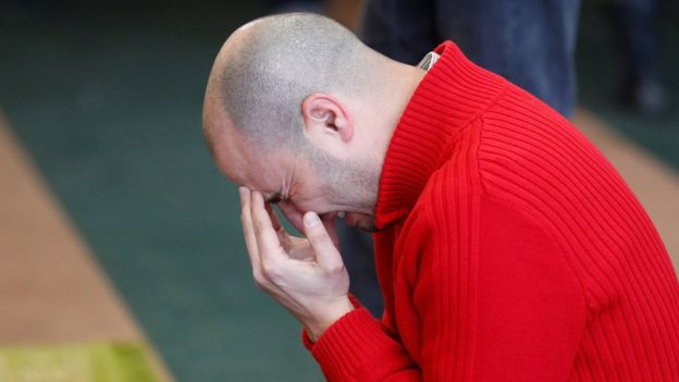 A worshipper weeps as he prays at the reopened Quebec Islamic Cultural Centre