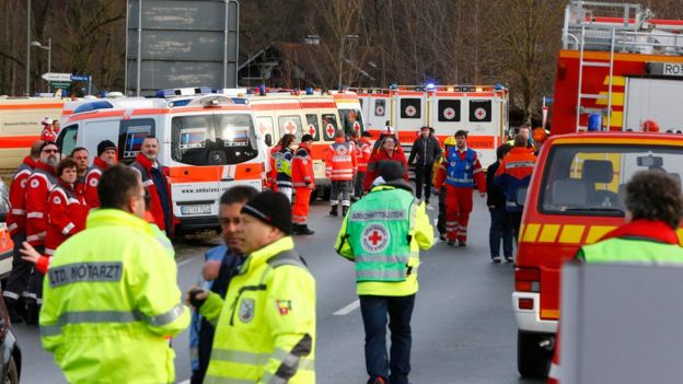 Rescue personnel wait in Bad Aibling, Germany, Tuesday, Feb. 9, 2016, after two regional trains crashed