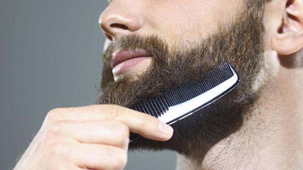 Man combing a beard