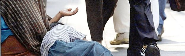 Woman and child begging (file image)