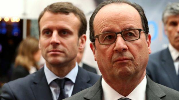 O ministro da economia da França, Emmanuel Macron, e o presidente Hollande; país mudou leis trabalhistas