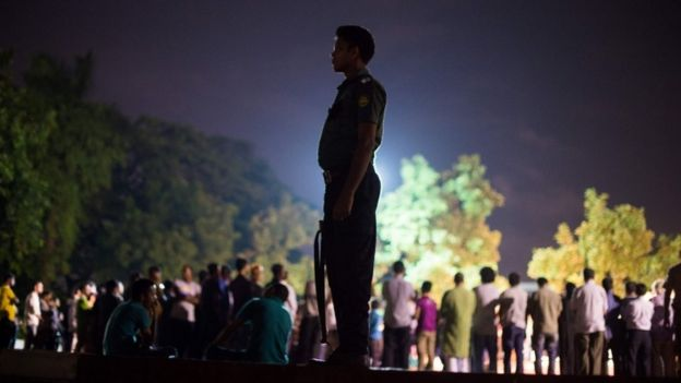 A Bangladeshi policeman stands guard during a peace rally