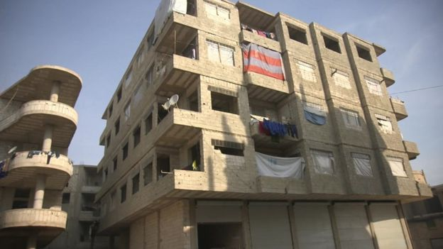 Unfinished building where he lives with his family in Jaramana, on the outskirts of the Syrian capital Damascus