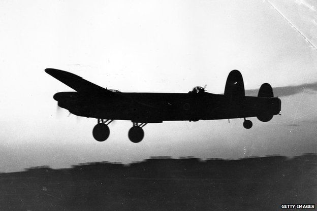 Avro Lancaster takes off at dusk on a bombing mission