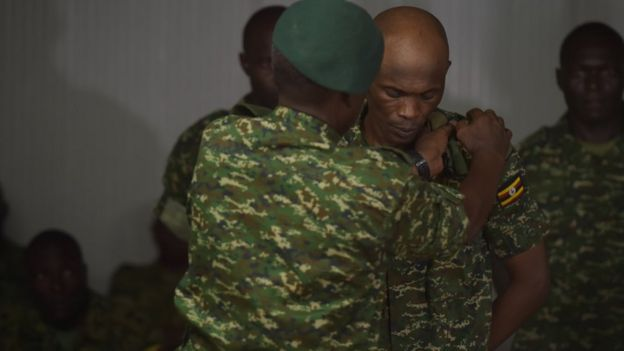 A soldier has his pips removed as he is stripped of his rank after a trail which found him guilty of pursuing personal gain and endangering operational efficiency in Mogadishu, Somalia, on 15 August 2016