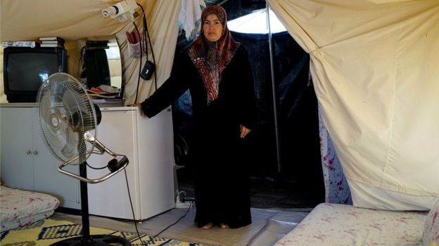 A Syrian refugee woman stands in her tent at a refugee camp in Osmaniye, Turkey, May 17, 2016