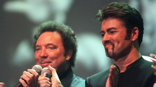 File photo dated 11/04/99 of Tom Jones (left) and George Michael performing a duet during a tribute concert to Sir Paul McCartney