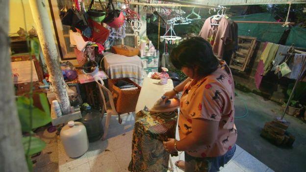 Patnaree Chankij ironing at home