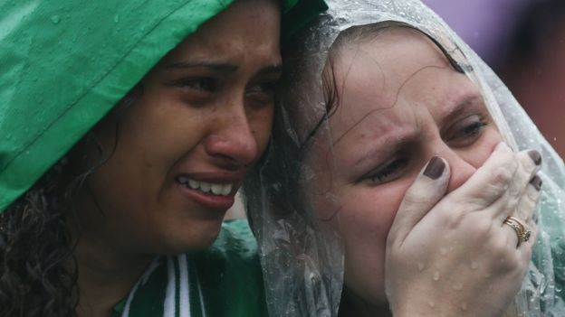 Fans came together in heavy rain at Chapecoense's stadium