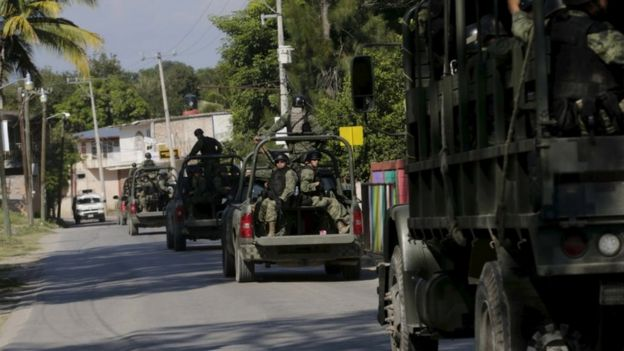 A military convoy patrols the town of Cocula, on the outskirts of Iguala,
