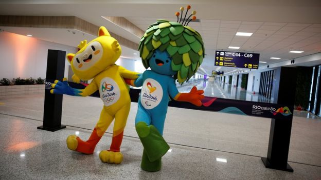 Olympic and Paralympic Games mascots Vinicius (L) and Tom pose during the opening ceremony of the new terminal at the international airport Galeao,