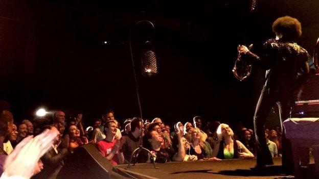 Prince performing with Simon Farmer's guitar