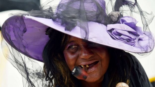 Voodoo followers take part in ceremonies honouring the Haitian voodoo spirits of Baron Samdi and Gede during Day of the Dead in a cementery in Port-au-Prince on 1 November, 2015.
