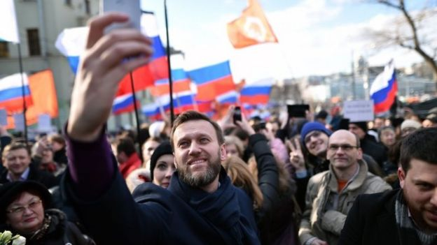 Alexei Navalny taking a selfie picture during a memorial march marking the one-year anniversary of the assassination of Russian politician Boris Nemtsov in central Moscow on 27 February 2016