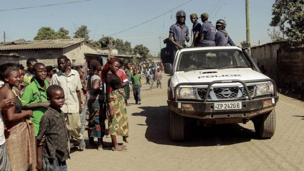 Zambian police patrol near the Chawama Compound where residents attacked and looted foreign-run shops in Lusaka - 19 April 2016