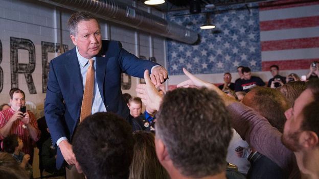 Republican presidential candidate Ohio Gov. John Kasich greets supporters following a rally at the Lansing Brewing Company on March 8, 2016 in Lansing, Michigan