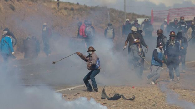 Miners clash with police