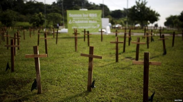 Crosses are left as a protest against the high homicide rate in the country in San Salvador, El Salvador on September 1, 2015. Members of a civilian group called