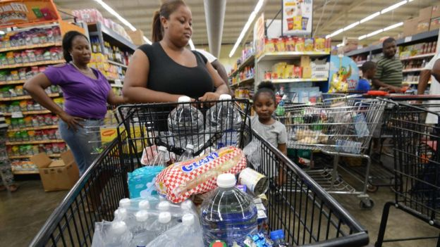 People buy groceries and supplies before the arrival of Hurricane Matthew in Portmore, Jamaica on 1 October