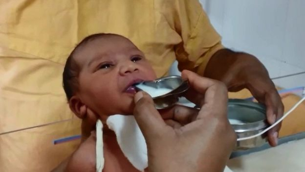 The baby being fed milk